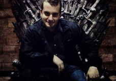 "Michail Charalambidis sitting on the Iron Throne, object of desire for the protagonists of popular fantasy series ""Game of Thrones"""